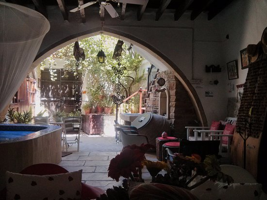 Kalavasos, Cyprus: The yard with the jacuzzi and the antiques. Also, coffee area and reading corner.
