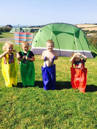 Widemouth Bay, UK: Our children playing outside in the hot sun x