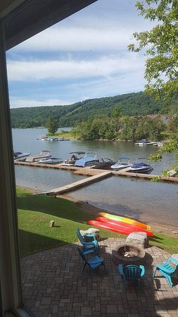 McHenry, MD: View of the hotel patio, fire pit and dock from the Lakeview suite kitchen.