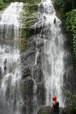 San Isidro de El General, Costa Rica : Waterfall rappelling at the homestay in the rainforest.