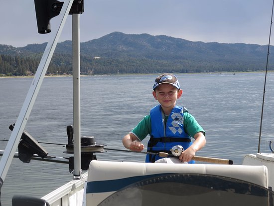 Big Bear Charter Fishing: Our grandson rigging up the lines!