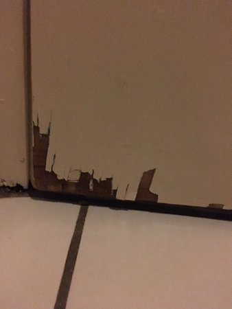 New Hartford, NY: bottom of bathroom door shattered