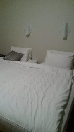 Aurora Cottages: This really happened. Two single beds with one doona 'for presentation.' Another doona was provi