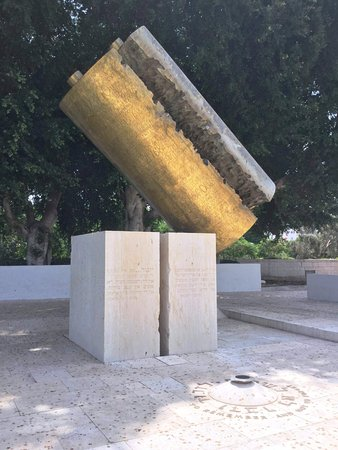 The Levinson Visitors Center : By Dani Karavan - a Bronze Torah split apart on Stone Blocks ..