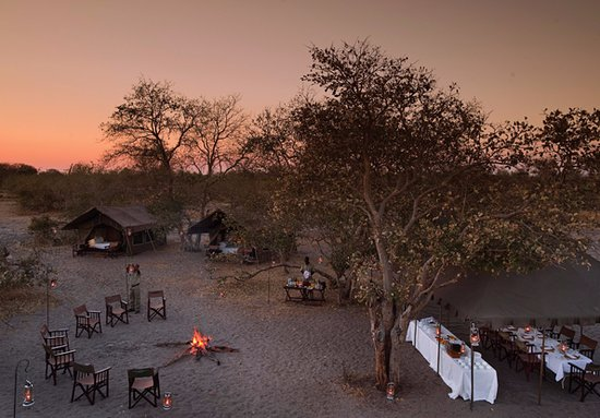 andBeyond Chobe Under Canvas: Luxury safari under canvas dinner set up ready for the guests return