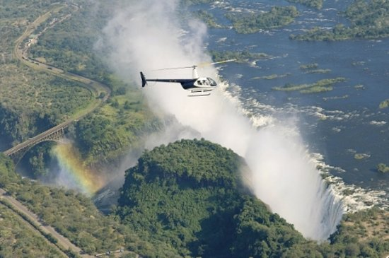 andBeyond Chobe Under Canvas: Flying over the mighty Victoria Falls with a Helipad ride on a tour extension