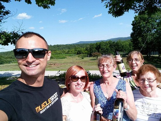 Danbury, NH: My family after our tastings with the bottles we bought. Great view, too!