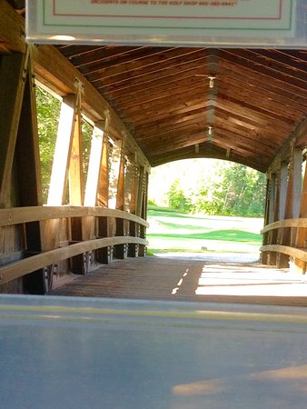 Wentworth Golf Club: You have to go though the covered bridge.