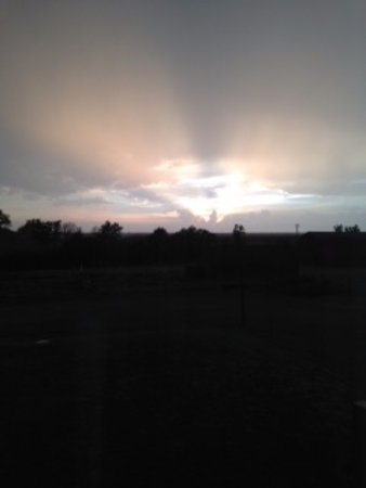 WaKeeney, KS: Sunset after storm, out second floor hallway window