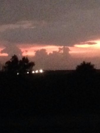 WaKeeney, KS: Outside 2nd floor hallway window at sunset (also shows lights of cars along I-70)
