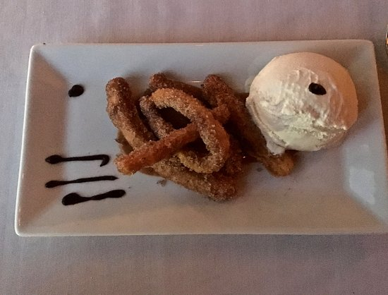 Towne Stove and Spirits: Spiced churros with vanilla ice cream, dulce de leche, chocolate sauce