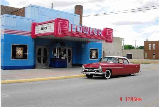 Recent photo of the Restored Art Deco Fowler Theatre and a vintage Chevy car owner patron