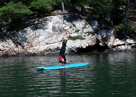 Acadia Stand Up Paddleboarding: Chris (instructor) and my cousin had a battle of who can do the craziest move on the paddleboard
