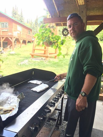 The Hutch B&B: My husband grilling our fresh halibut on the grill in the back!
