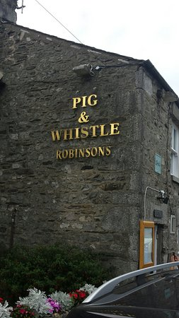 Cartmel, UK: The outside sign on this little pub