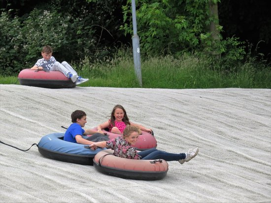 Gillingham, UK: great fun,and wears them out as they have to drag the doughnuts back to the top of the hill
