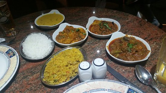 Kendal, UK: Boiled rice, veg pilau, aloo gobi, bindi bhaji, tarka daal and brinjal