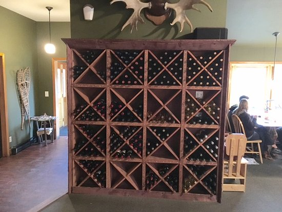 The Perch Restaurant and Bar: The Perch Restaurant wine rack, entrance to left.