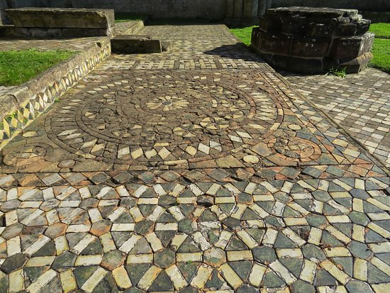 Coxwold, UK: Tiles preserved, left as they were.
