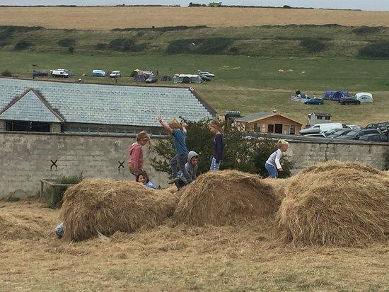 Osmington Mills, UK: Children can play in the hay bales