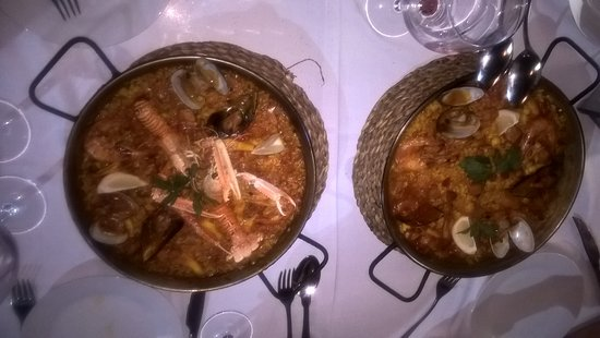 El Choto Restaurante: Two versions of paella for our party. Perfectly cooked.