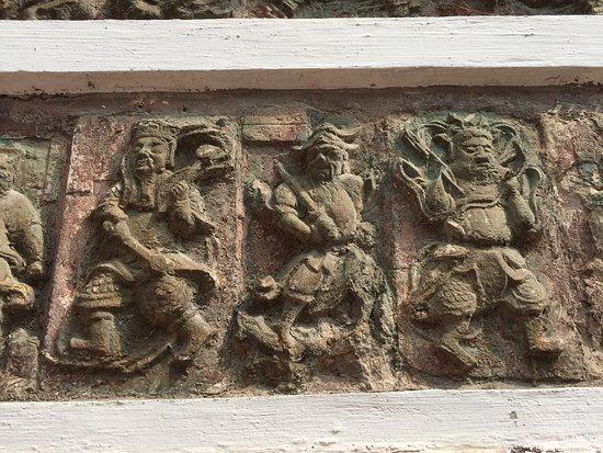 Jingzhou, Китай: stone carving.