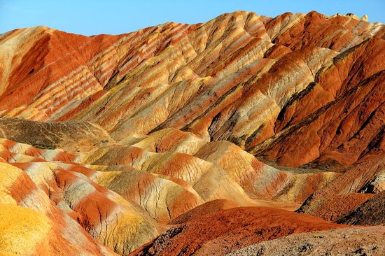 Linze County, Cina: Danxia, from different viewing points and sun light.