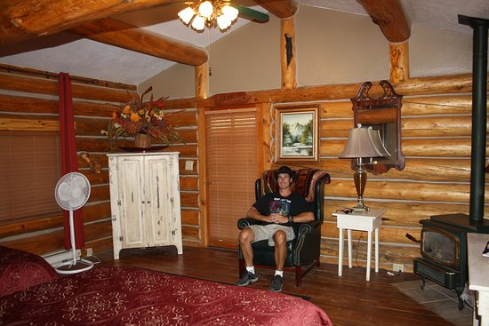 The Old Mill Log Cabins Photo