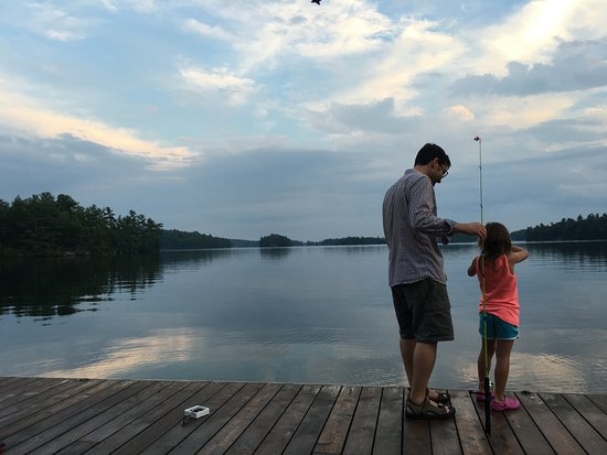 Port Severn, Καναδάς: The view from the dock, which is just gorgeous, with my husband and daughter having fun.