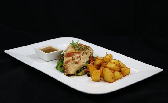 Ptuj, Slovenia: Boneless chicken thigh and drumstick with potatoes and vegetables