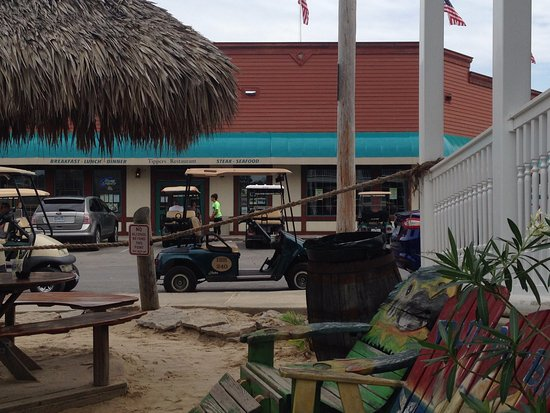 Mojito Bay Tiki Bar: That's our rental golf cart; parking is really close by at the right hours.