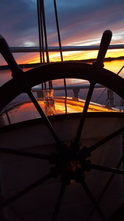 Rockland, ME: Ship's wheel at sunset.