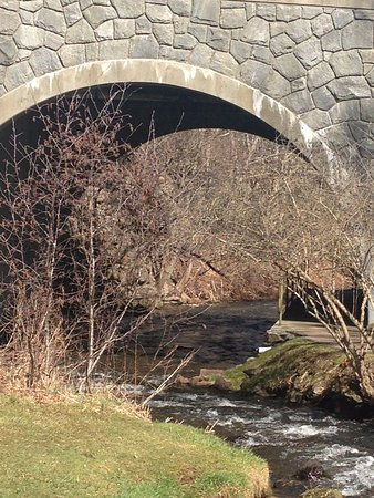 Brewster Gardens: This is a view under a bridge about halfway along the walk to the Grist mill.