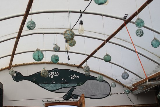 Kenai, AK: Decore of fishing floats in the glassed roof eating area.