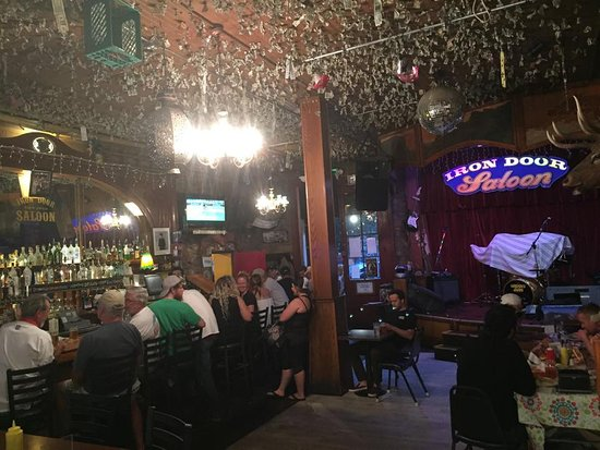 Iron Door Saloon and Grill : Those are $1 bills flung on ceiling wet wrapped in a coin. When they fall down, it gets donated.