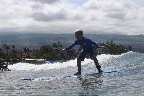 Waves Hawaii Surf School: Up the first try & have these great pics for the memories.