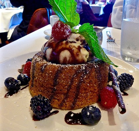 Daly City, CA: warm butter cake with gelato and berries - drizzled with chocolate sauce!  Yum.