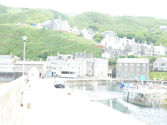 The harbour at Gardenstown, the big grey building is the heritage centre.