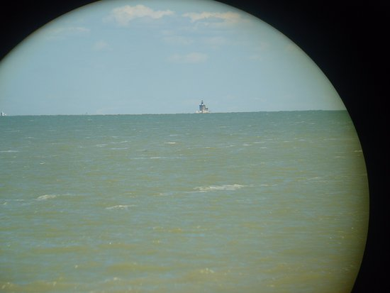 Toledo, OH: Looking at the lighthouse through the quarter binoculars from the state park. :(