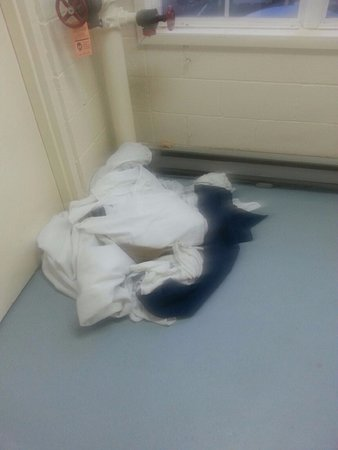 Pottstown, PA: dirty bed linens left in stairwell...notice pizza crust on heater