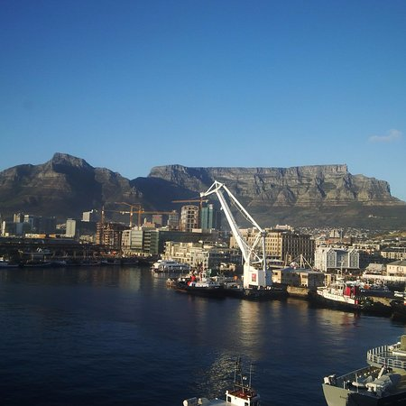 The Table Bay Hotel: Harbour and mountain view from room on a clear day - sea views are good but this is the best