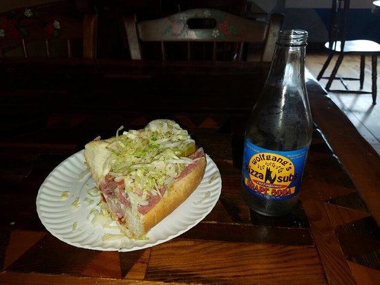 Wolfeboro, Нью-Гэмпшир: Half of my small Italian sub.  Great sandwich, interesting decor, friendly service. Definitely w
