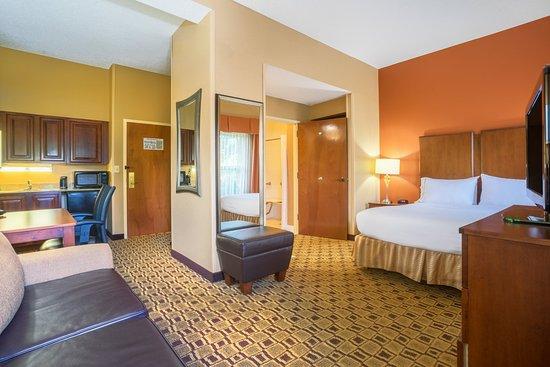 Huntersville, NC: Our Queen Suite features visual door, phone and alarm alerts