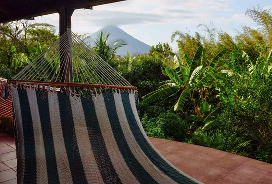 Balgue, Nicaragua: Put your feet up and enjoy the volcano & lake views from the front porch of the Homestead House