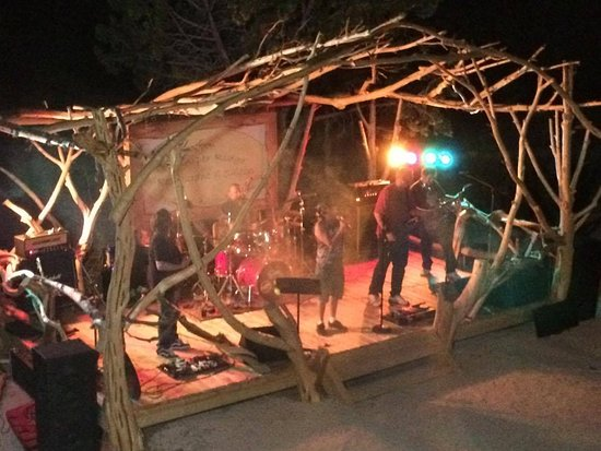 live outdoor stage hand built from local wild harvested juniper