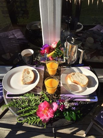 Katikati, New Zealand: breakfast table set compete with fresh flowers from the hamper!
