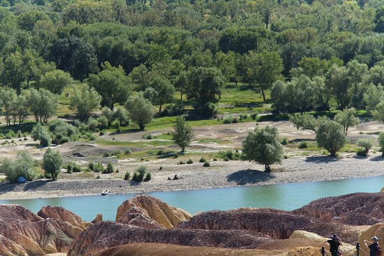 Burqin County, China: The river separates the rocky side and the greenery side of the beautiful site.