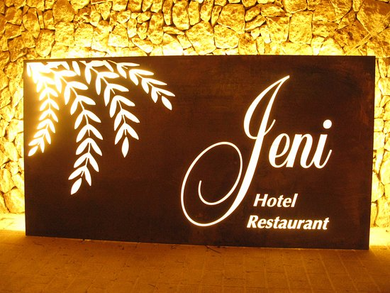 Hostal Jeni: Illuminated sign at the back of the hotel.