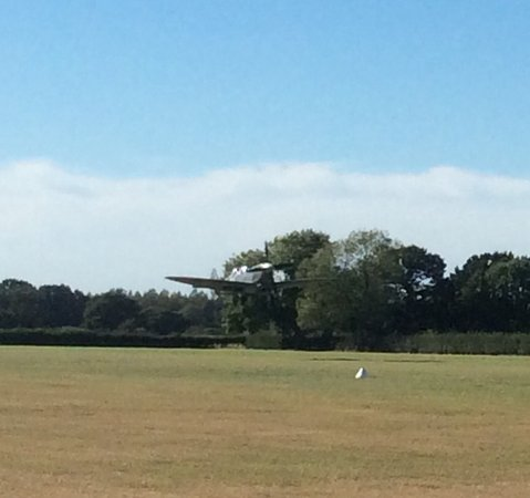 Headcorn, UK: The two seater spitfire landing after the fligt