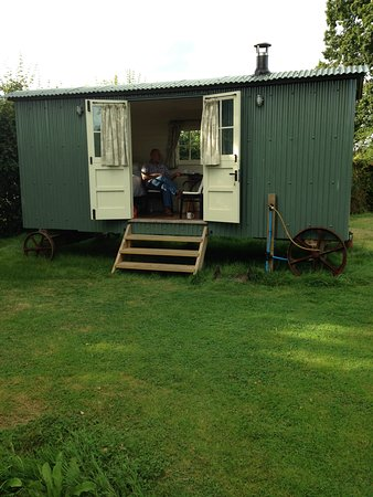 Headcorn, UK: Bed inside left; sink, kettle, fridge in middle; shower room to right.